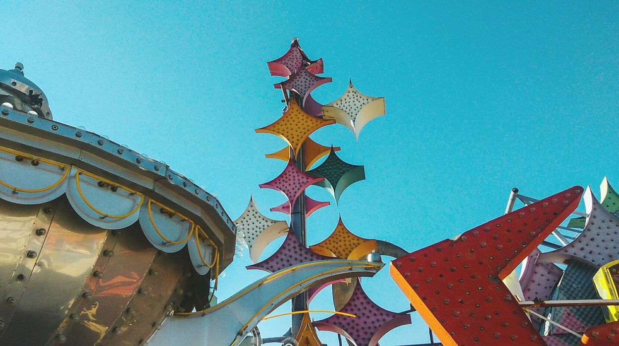 Arts Culture And Entertainment Blue Built Structure Architecture Low Angle View No People Day Outdoors Clear Sky Sky Astrology Sign Carousel Close-up Low Angle View Multi Colored Modern Neon Sign Neon Museum Las Vegas Museum Urban Skyline
