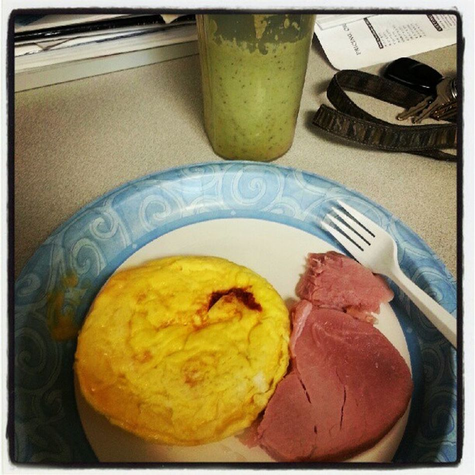 Healthy Breakfast egg omelet with cheese, ham, and veggie/fruit smoothie