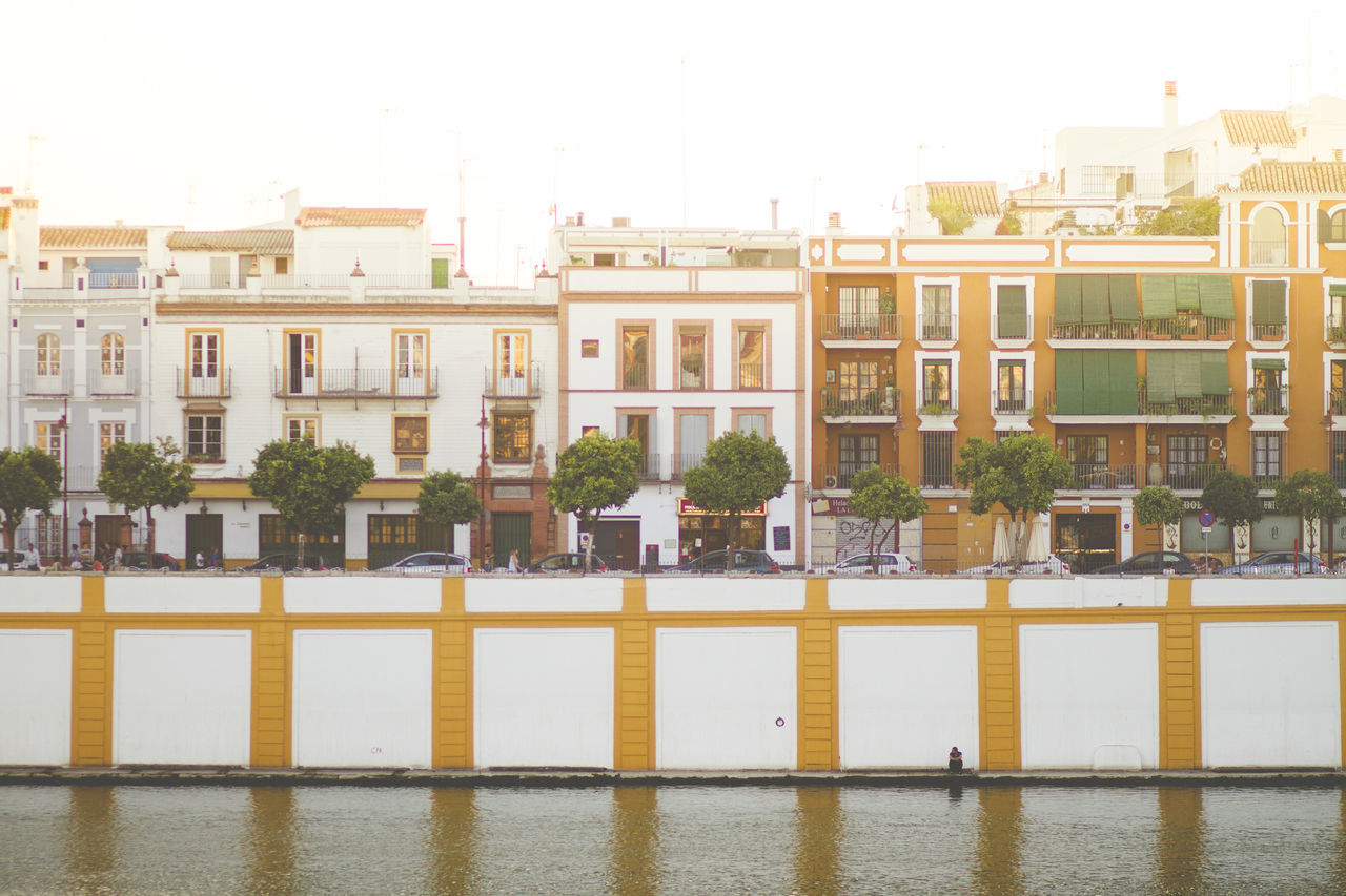 Architecture Building Exterior Built Structure City Day No People Outdoors Residential Building River Riverside Sevilla Sky SPAIN Travel Travel Destinations Tree Water