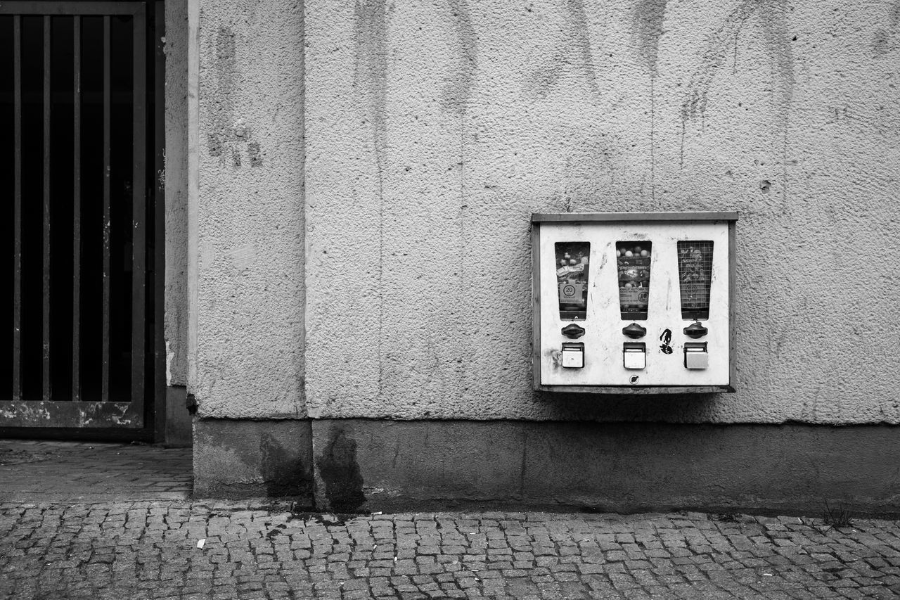 Architecture Black & White Black And White Built Structure Closed Gate Gloomy Gumball Machines House Wall My Fucking Berlin Shabby Street Street Photography Streetphotography Vending Machine Wall Monochrome Photography