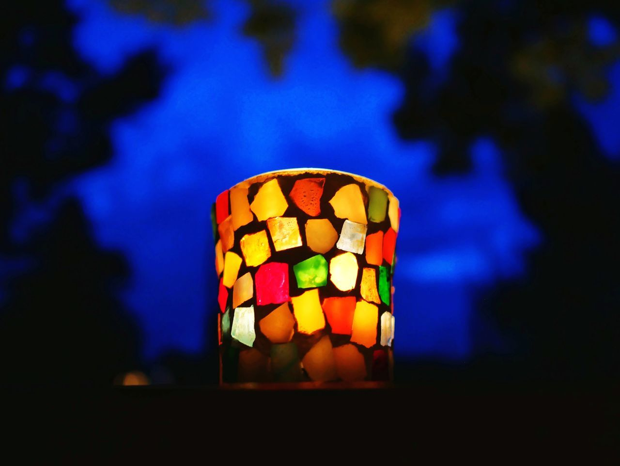Decorated Candle At Dusk