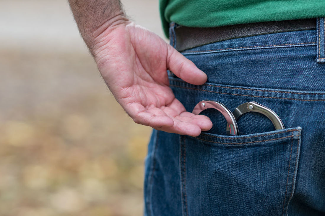 Metal handcuffs in back jeans pocket Crime Freedom Suspicion Addict Addicted Addiction Arrest Back Pocket Casual Clothing Chain Close-up Criminal Fraud Handcuffs  Hostage Illegal Jeans Law Legal One Person Outdoors Police Punishment Slavery And Freedom Terrorism