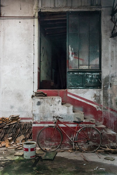 Abandoned Architecture Bike Building Exterior Built Structure Colored Day Desolate Destroyed Door Faded Lines No People Old Outdoors Stairs Tatty Urbex Vintage Wall Wall - Building Feature Window