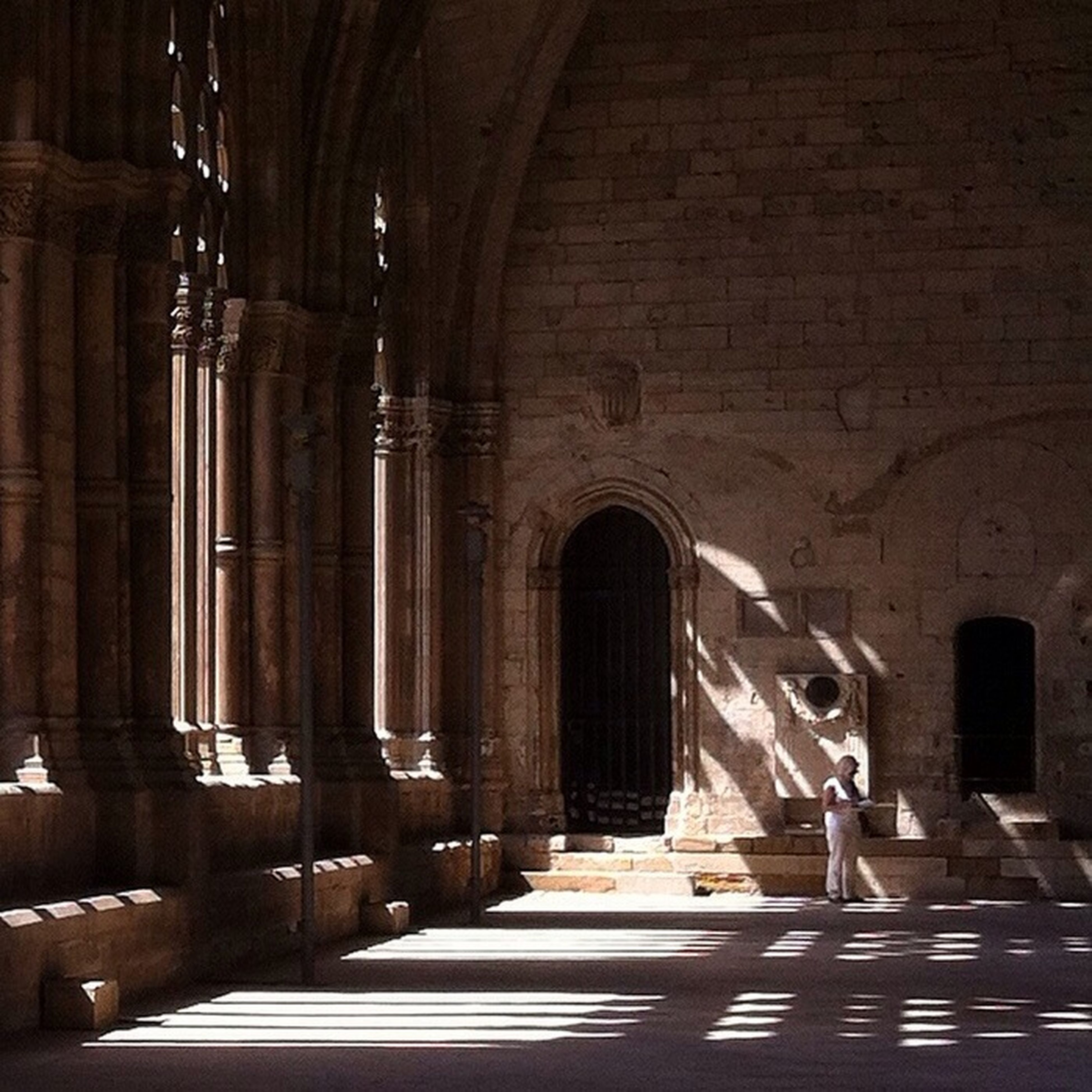 arch, architecture, built structure, indoors, history, old, archway, building exterior, entrance, architectural column, corridor, historic, church, the way forward, the past, building, interior, religion, door
