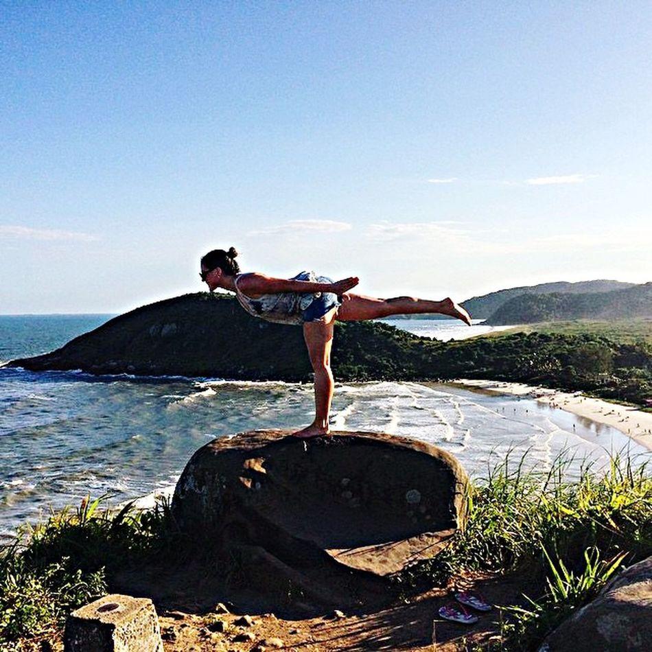 Practicing derosemethod Beach yoga Ilhadomel