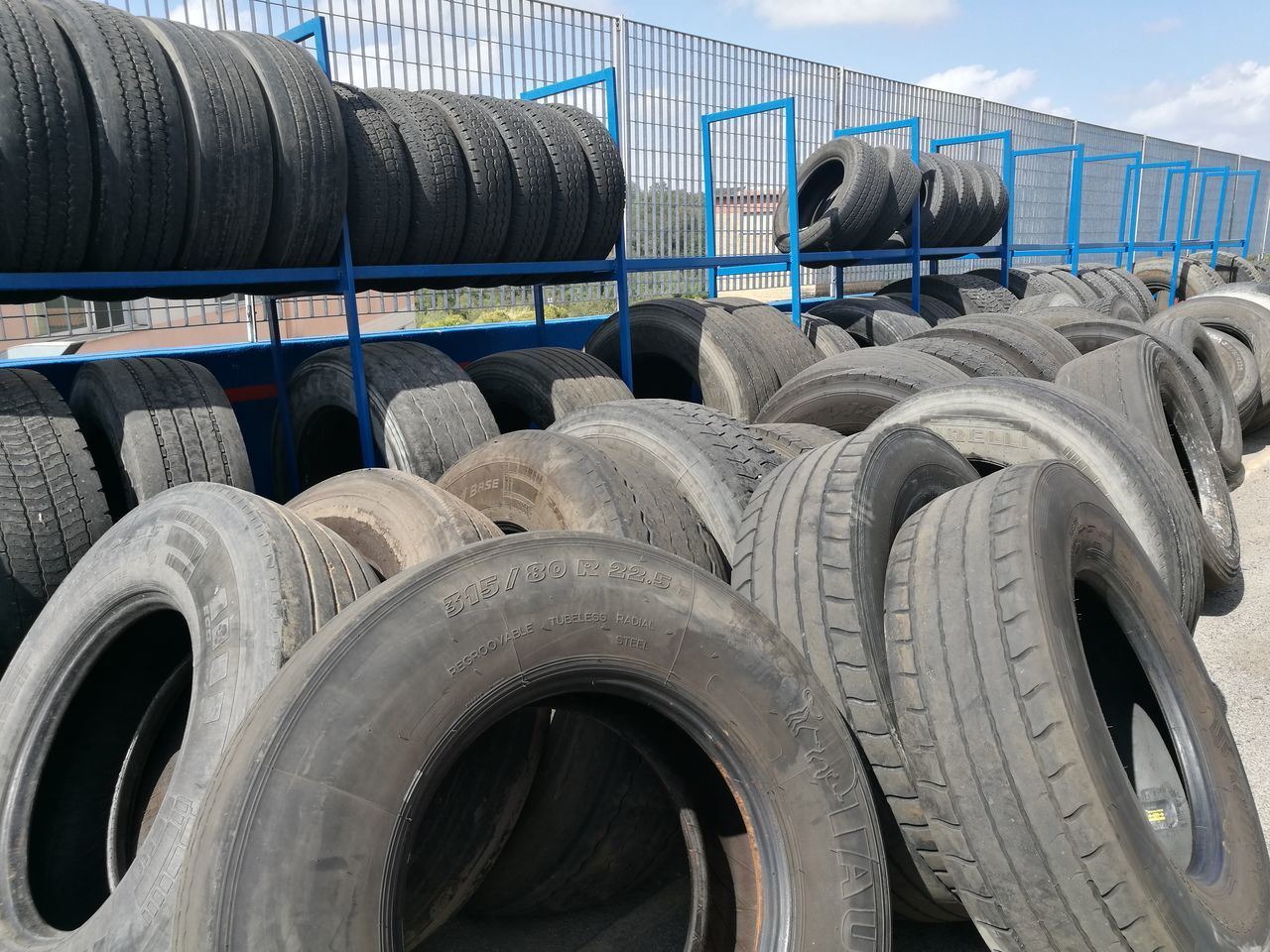 tire, large group of objects, transportation, wheel, arrangement, day, no people, freight transportation, outdoors, road, close-up