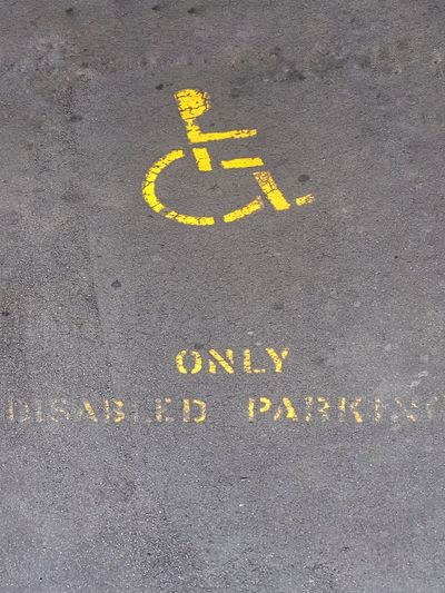 Only disable parking Mark Abstract Disability  Man Yellow Signal Sign Disable Communication Text Yellow Asphalt No People Day Outdoors Differing Abilities Wheelchair Access Wheelchair Mobility In Mega Cities