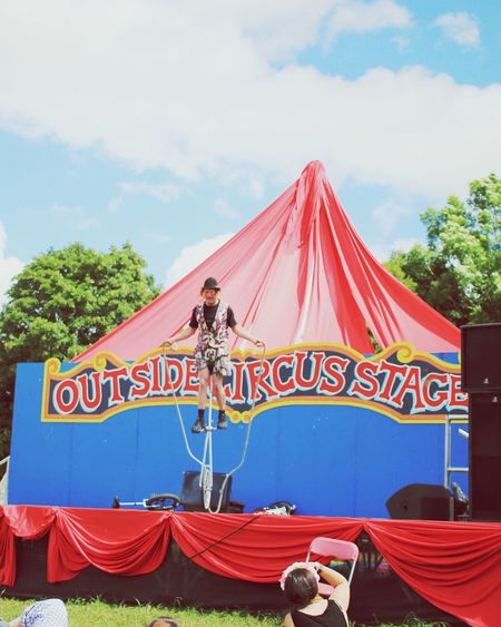 Glastonbury Music Festival Circus Unicycle Skipping Clown Outside Stage at Glastonbury Festival
