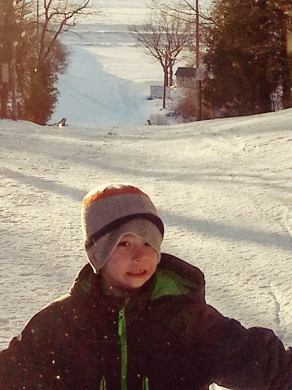 winter, cold temperature, snow, childhood, real people, one person, warm clothing, weather, boys, leisure activity, outdoors, day, nature, tree, lifestyles, full length, child, one boy only, snowing, people