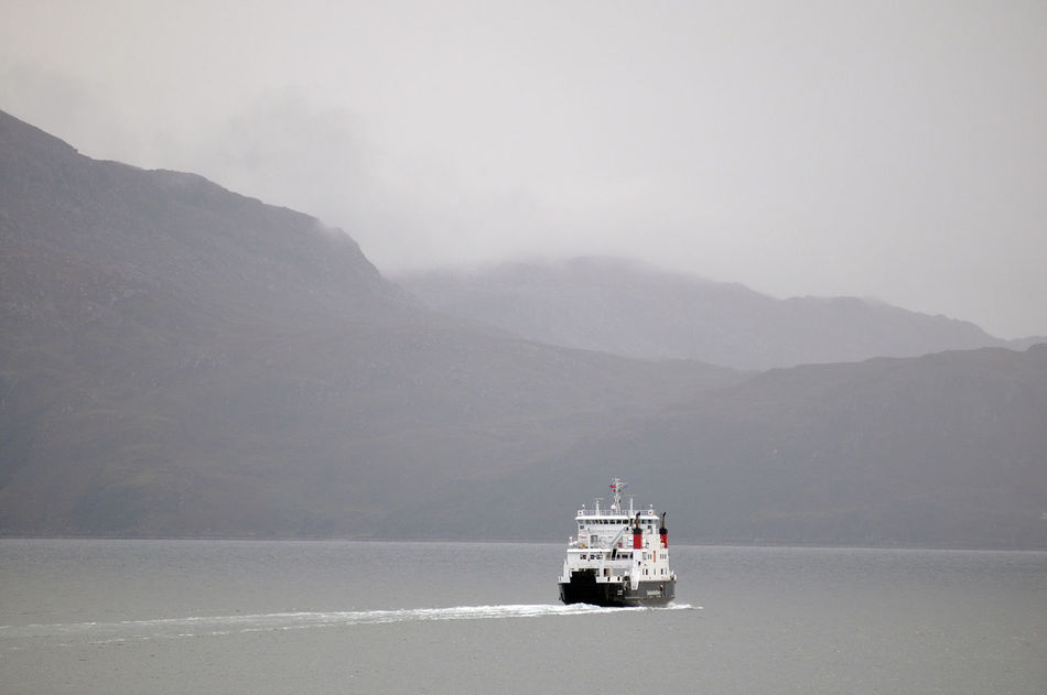 Ferry heads out from Armadale on the Isle of Skye on route to Mallaig on the west coast of Scotland. Beauty In Nature Boat Ferry Highlands Journey Landscape Mist Misty Mountains  Mode Of Transport Mountain Mountain Range Nautical Vessel No People Non-urban Scene Remote Sailing Ship Skye Tranquility Transportation Travel Destinations Water Weather