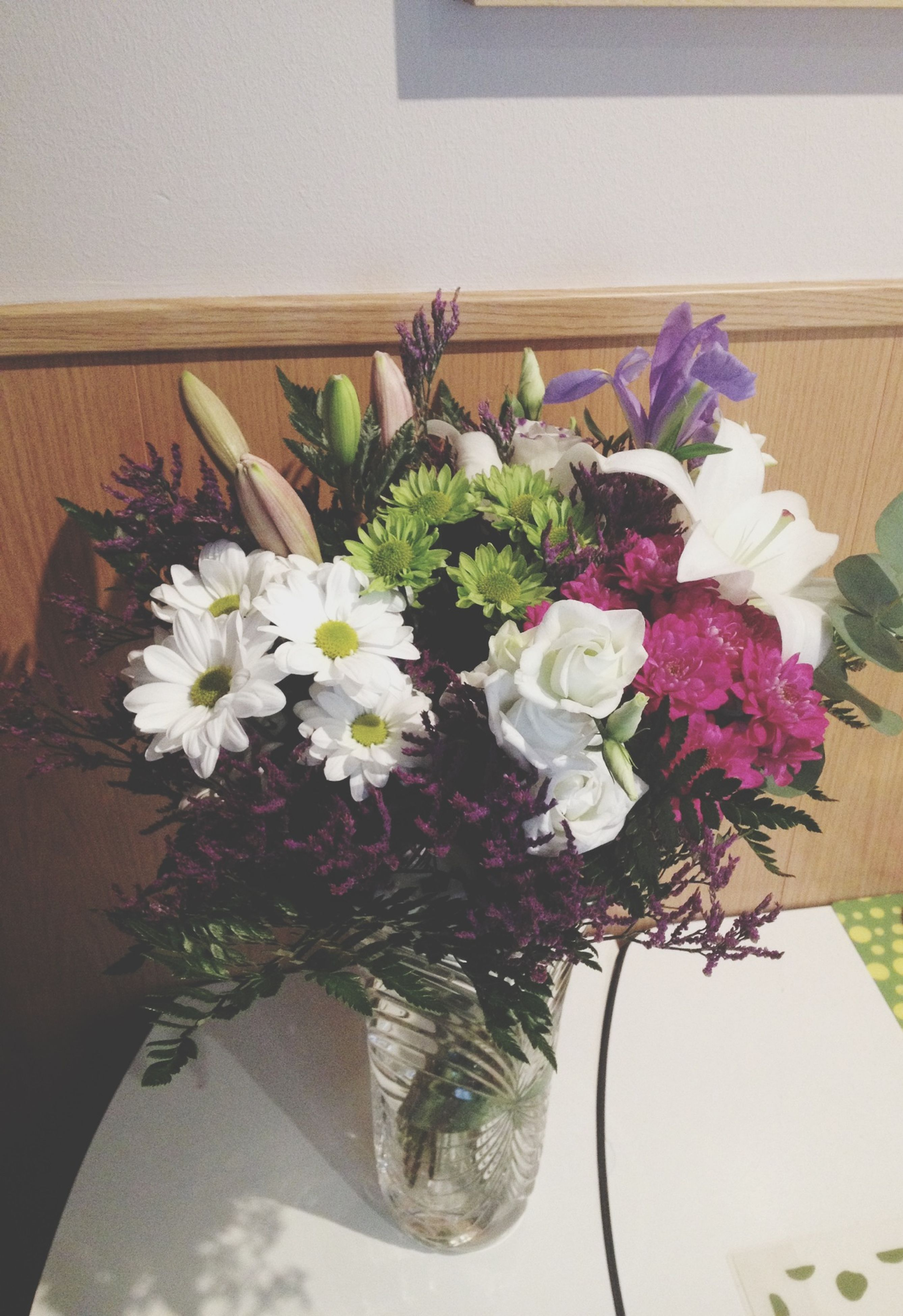 flower, indoors, vase, freshness, fragility, petal, decoration, bouquet, flower arrangement, bunch of flowers, flower head, potted plant, white color, table, home interior, growth, plant, beauty in nature, flower pot, close-up