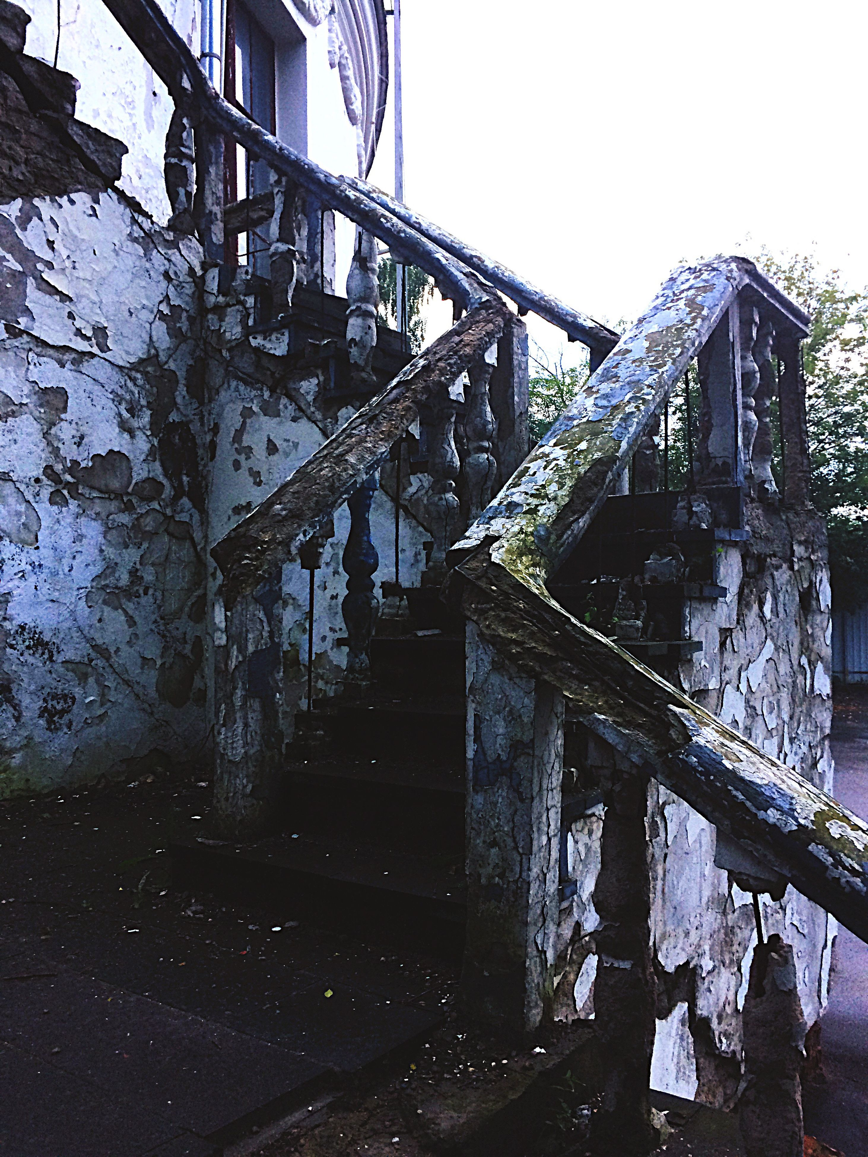 architecture, built structure, connection, bridge - man made structure, low angle view, wall - building feature, damaged, abandoned, clear sky, bridge, destruction, weathered, railing, deterioration, obsolete, building exterior, footbridge, bad condition, day, sky, demolished, outdoors, engineering, no people, messy