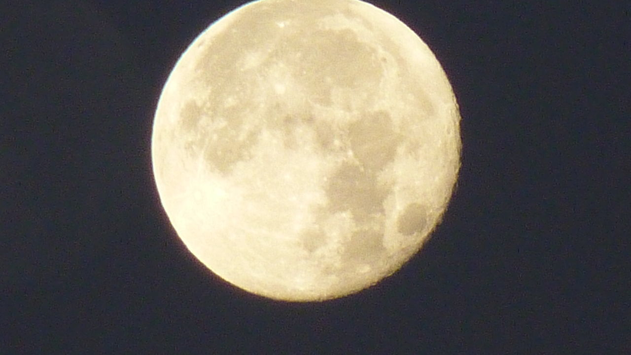 moon, astronomy, night, circle, planetary moon, beauty in nature, moon surface, nature, low angle view, scenics, clear sky, tranquil scene, tranquility, no people, space exploration, outdoors, sky, half moon, close-up, space