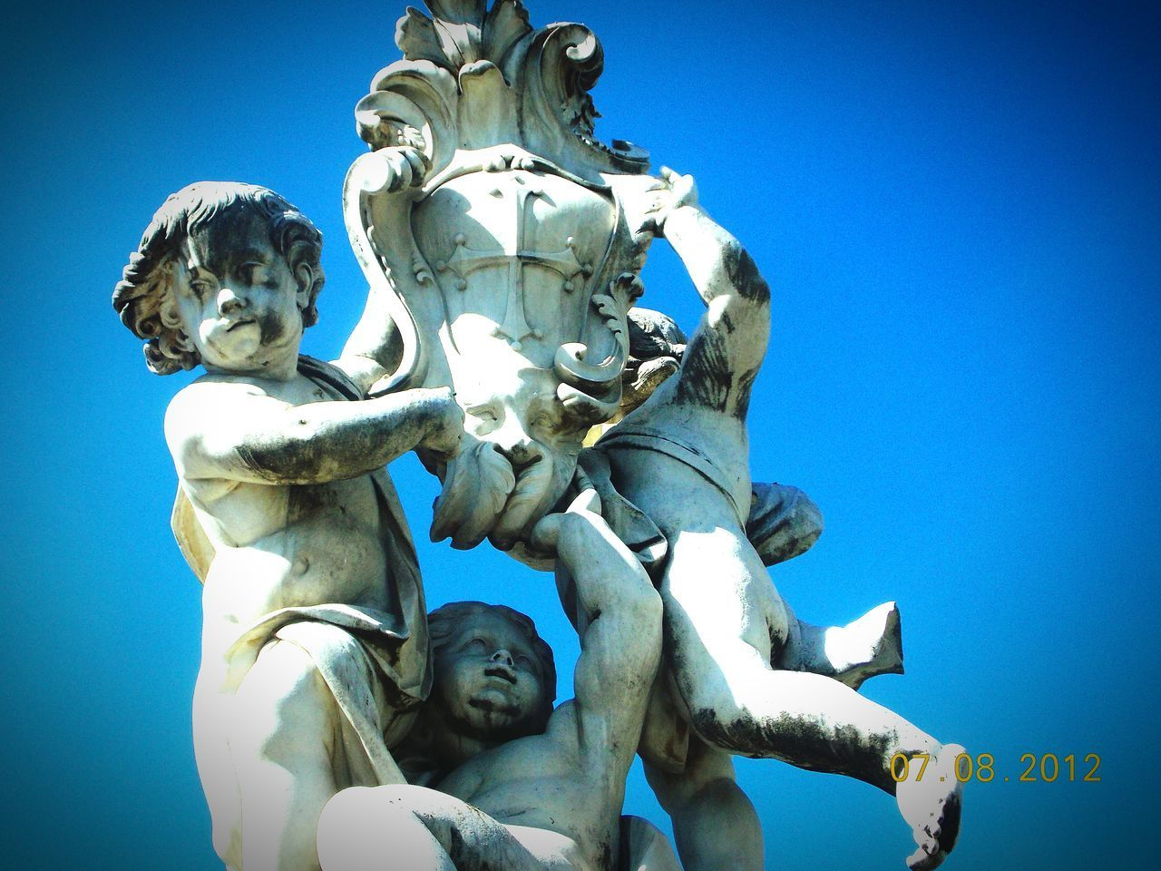 Monumentos children Statue Sculpture Human Representation Blue Low Angle View No People Clear Sky Religion Sky Outdoors Day Astrology Sign Representing Close-up