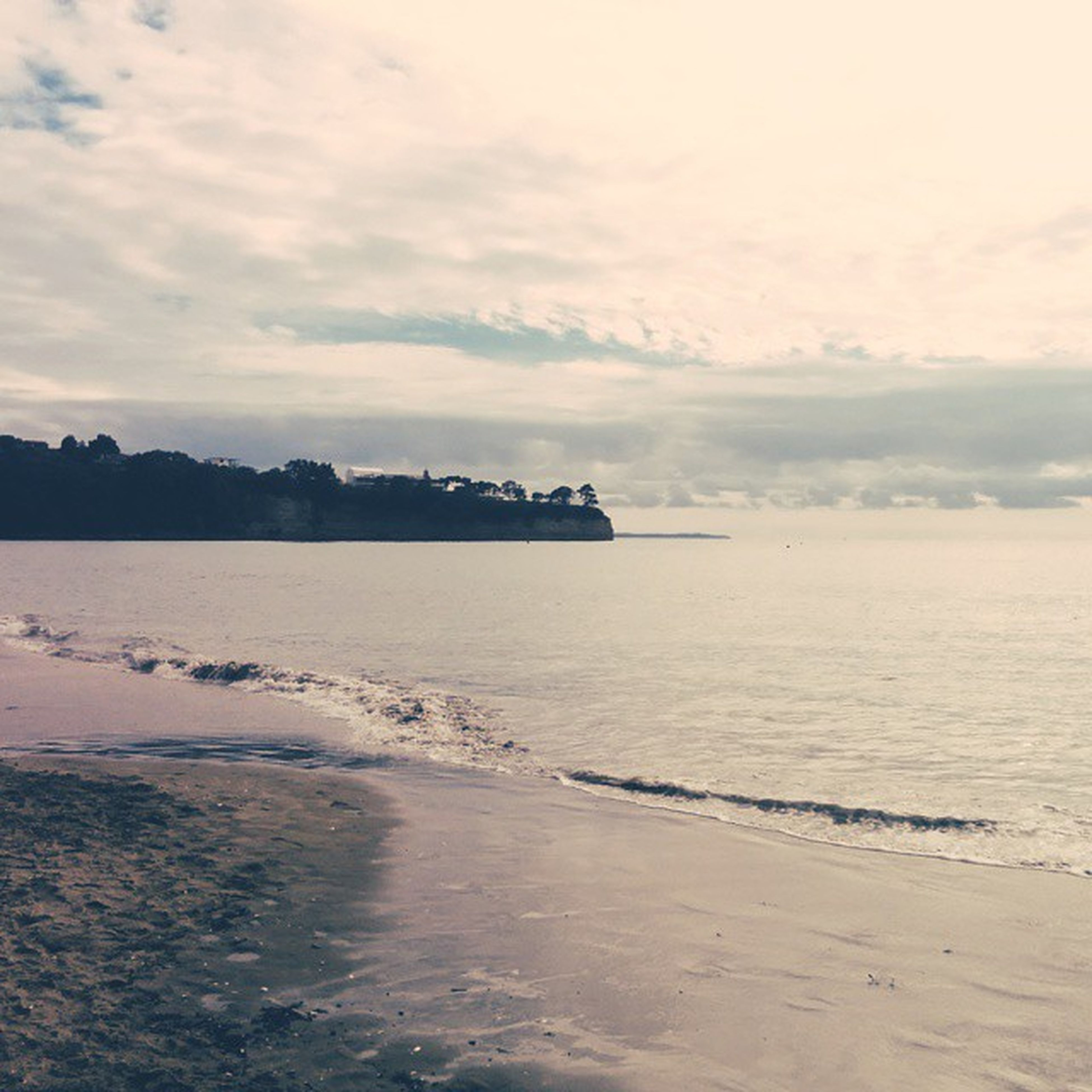 water, sea, sky, tranquil scene, tranquility, scenics, beach, beauty in nature, cloud - sky, shore, horizon over water, nature, cloudy, cloud, sand, idyllic, calm, coastline, waterfront, outdoors