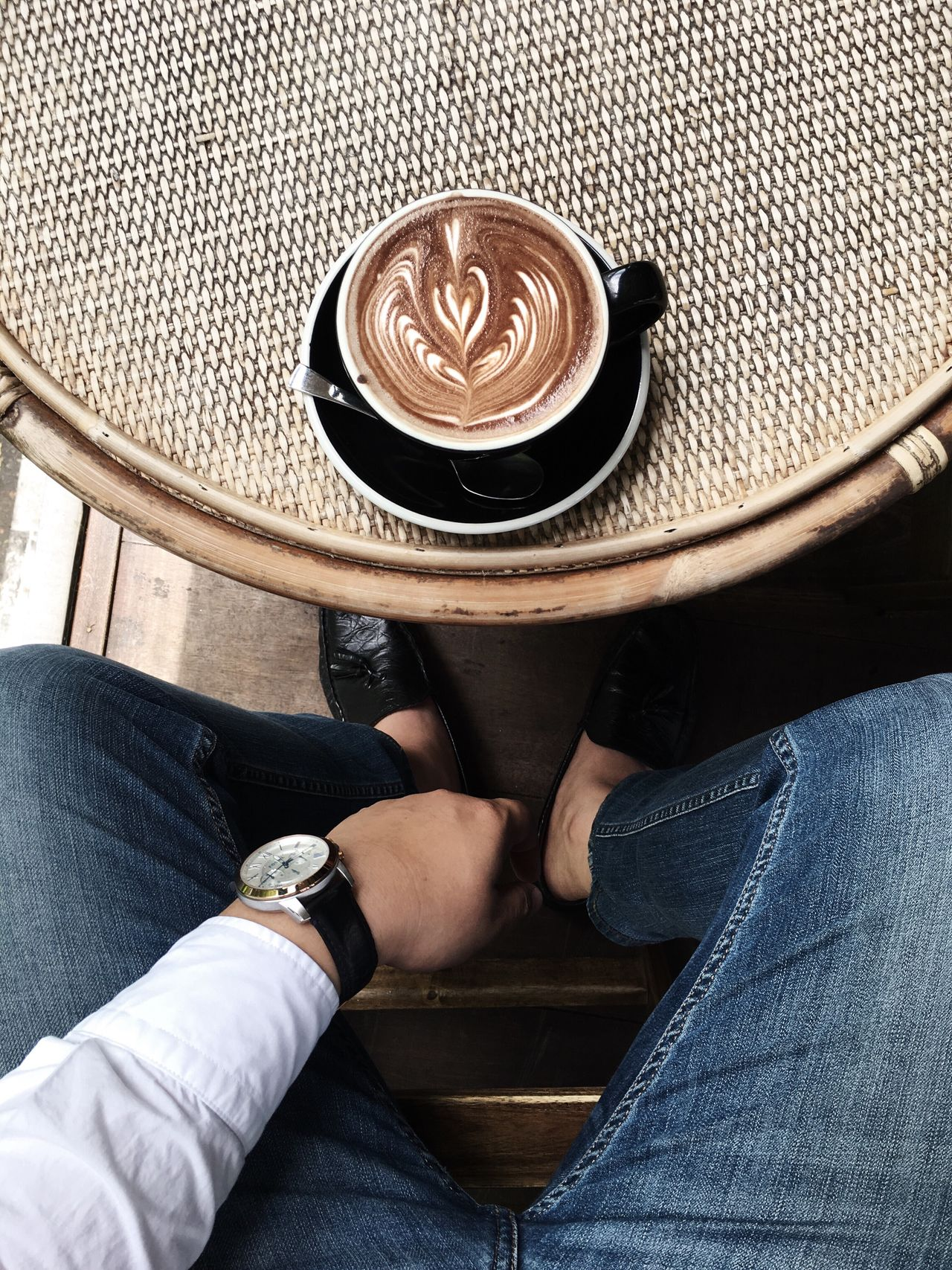 Jeans Sitting Food And Drink Drink Casual Clothing Lifestyles One Person Low Section Indoors  Human Body Part Leisure Activity Women Human Leg Refreshment Real People Table Men Adults Only Adult Close-up Coffee