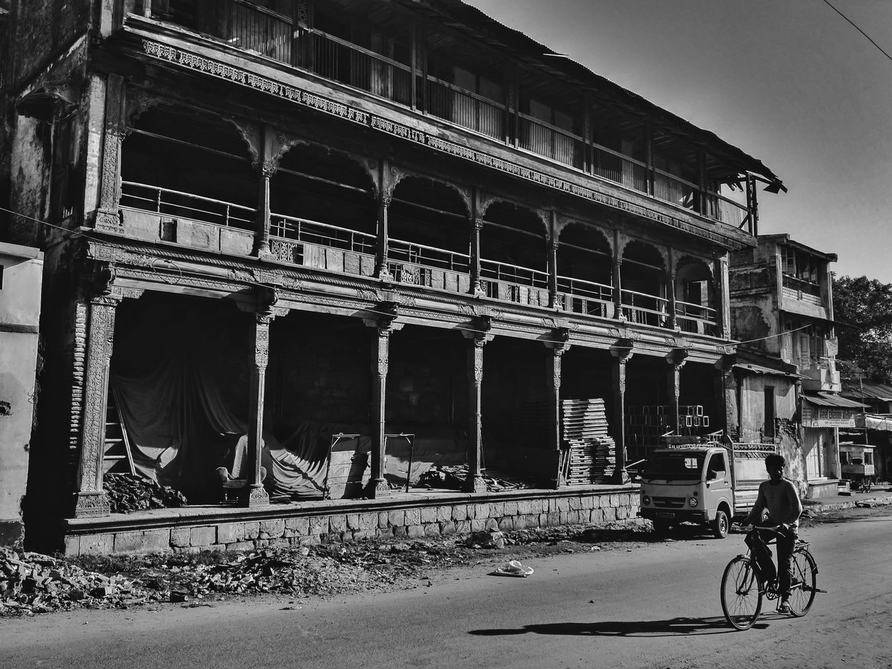 architecture, built structure, building exterior, transportation, architectural column, bicycle, bridge - man made structure, history, outdoors, real people, travel destinations, men, day, sky, one person, city, people