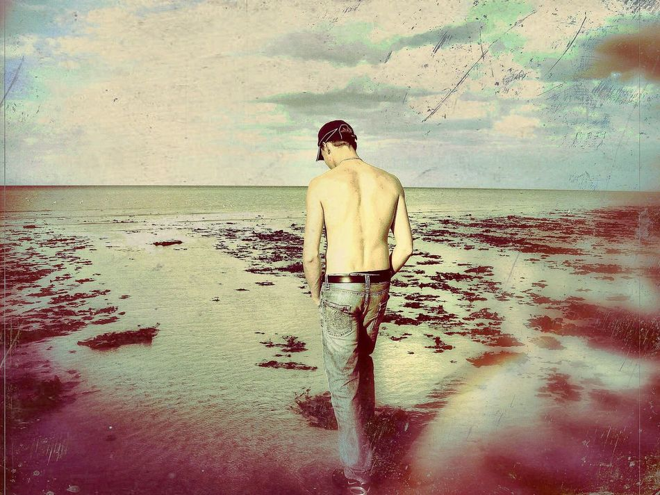 Beach walk :) Rear View Sea One Person Beach Real People Shirtless Day Outdoors Nature People Water Young Adult Sky Creative Lovephotoeffect Artistic Summertime Beachphotography Beautiful Nature Beatifulday Beautiful Day Welcome To Black The Secret Spaces
