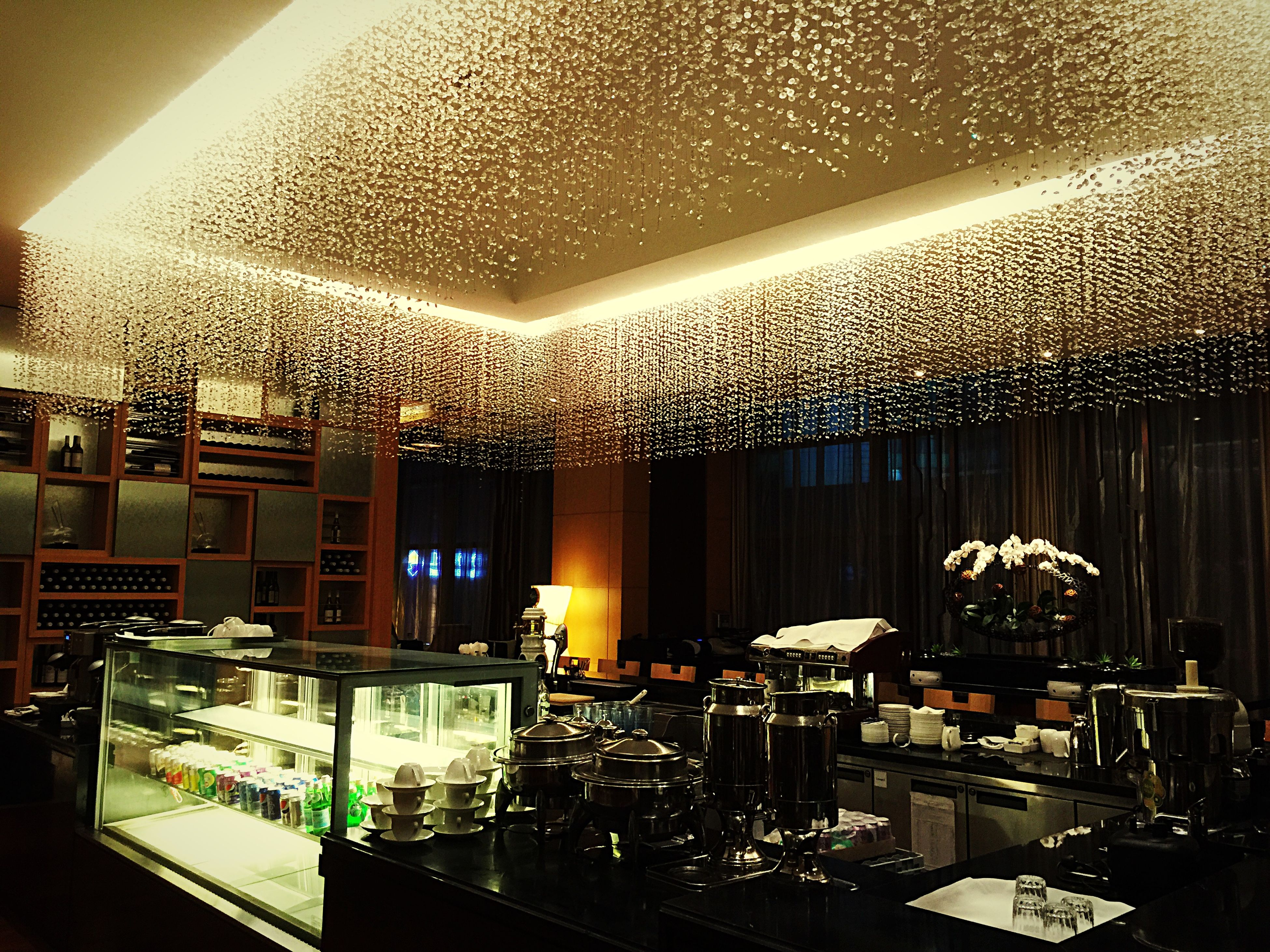 indoors, window, lighting equipment, ceiling, illuminated, glass - material, table, chair, architecture, built structure, transparent, home interior, hanging, empty, electric lamp, absence, restaurant, no people, decoration, interior