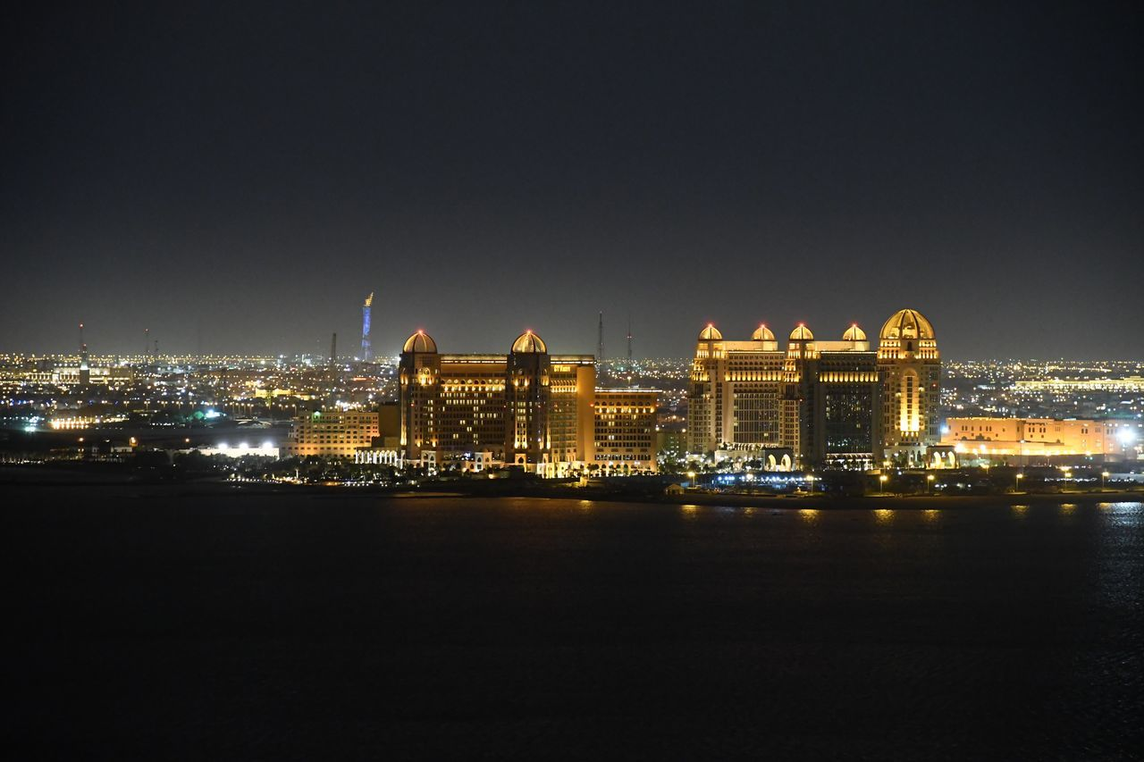 built structure, architecture, illuminated, building exterior, night, water, waterfront, city, travel destinations, no people, sky, outdoors, cityscape, clear sky