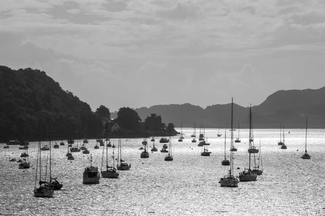 Isle of Mull, Scotland - boats lying in an outlet to the sea, black and white Black & White Blackandwhite Blackandwhite Photography Boat Boats Harbor Monochrome Mountain Outdoor Photography Outdoors Scotland Sea Sea And Sky Seascape Sky Water