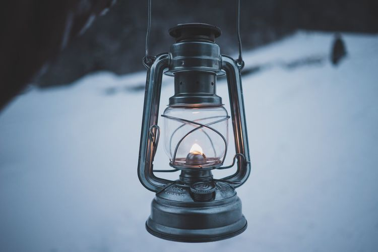 Oil lamp outdoors Living Explore Roam Adventure Live Authentic Moody Mood Nostalgic  Authentic Mountain Snow Outdoors Photograpghy  Candle Flame Lighting Equipment Indoors  Burning Focus On Foreground Illuminated Close-up Oil Lamp Day No People
