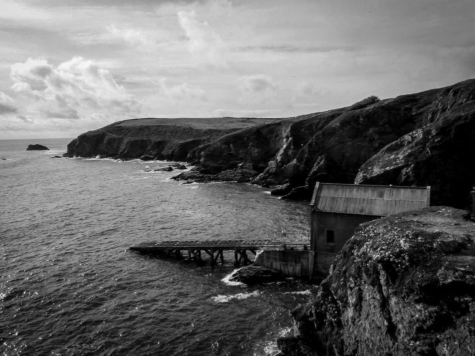 standing still after all this time Sea And Sky Cornwall Beauty In Everything Cliffs And Sea For My Friends That Connect AMPt_community Cliffs And Water No People Cornwall Uk Seascape Beauty In Nature Summertime EyeEm Nature Lover Ocean Water Nature Sea View Monochrome Rocks And Water Black And White Lifeboat Station... Architecture Buildings