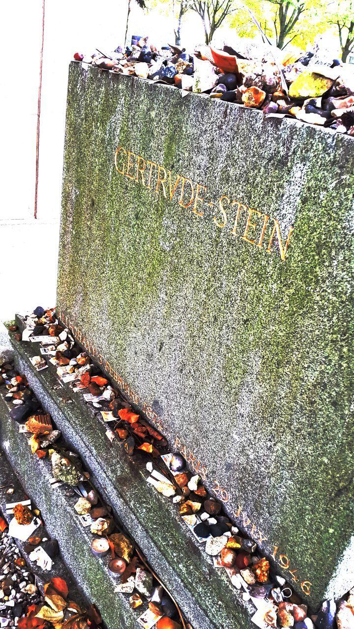 Stones On Tombstone In Cemetery