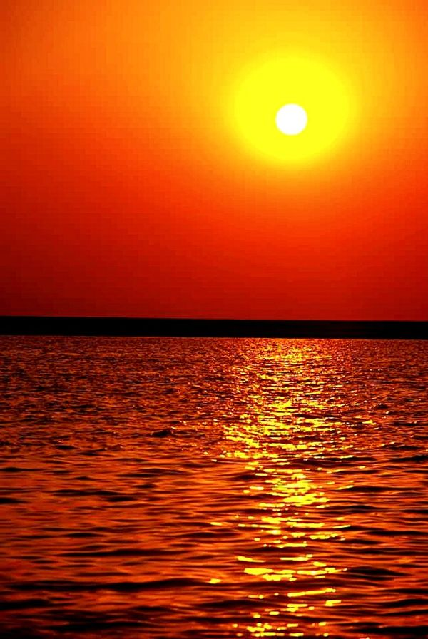 Sunset Sea Sun Orange Color Scenics Beach Horizon Over Water Beauty In Nature Reflection Nature Tropical Climate Water Vacations Gold Colored Tranquil Scene Tourism Vibrant Color Sky Travel Summer