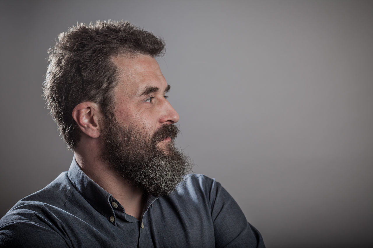 Mature man with long beard, head shots on grey background Adult Adults Only Beard Blank Expression Casual Clothing Colored Background Contemplation Emotions Gray Gray Background Grey Background Headshot Human Face Mature Adult Men Mid Adult One Man Only One Mature Man Only One Person Only Men People Portrait Series Serious Studio Shot