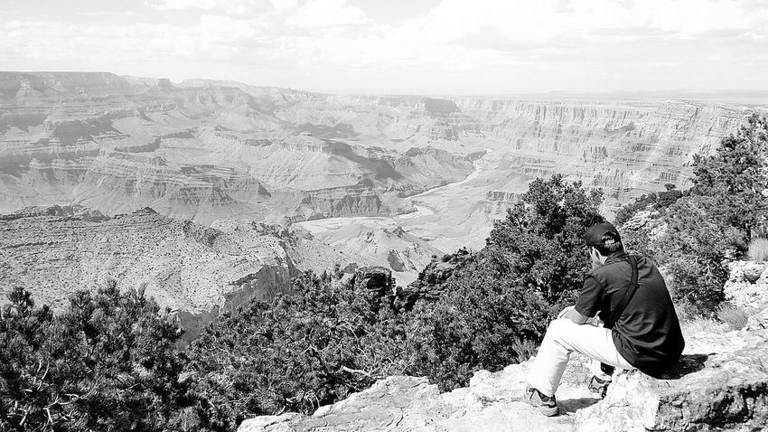 Sitting Day Men Outdoors Mountain Nature Beauty In Nature Landscape One Man Only Grand Canyon, South Rim Travel Destinations Canyons National Parks South Rim National Park Nature Grand Canyon National Park Old-fashioned Beauty In Nature Scenics Grand Canyon