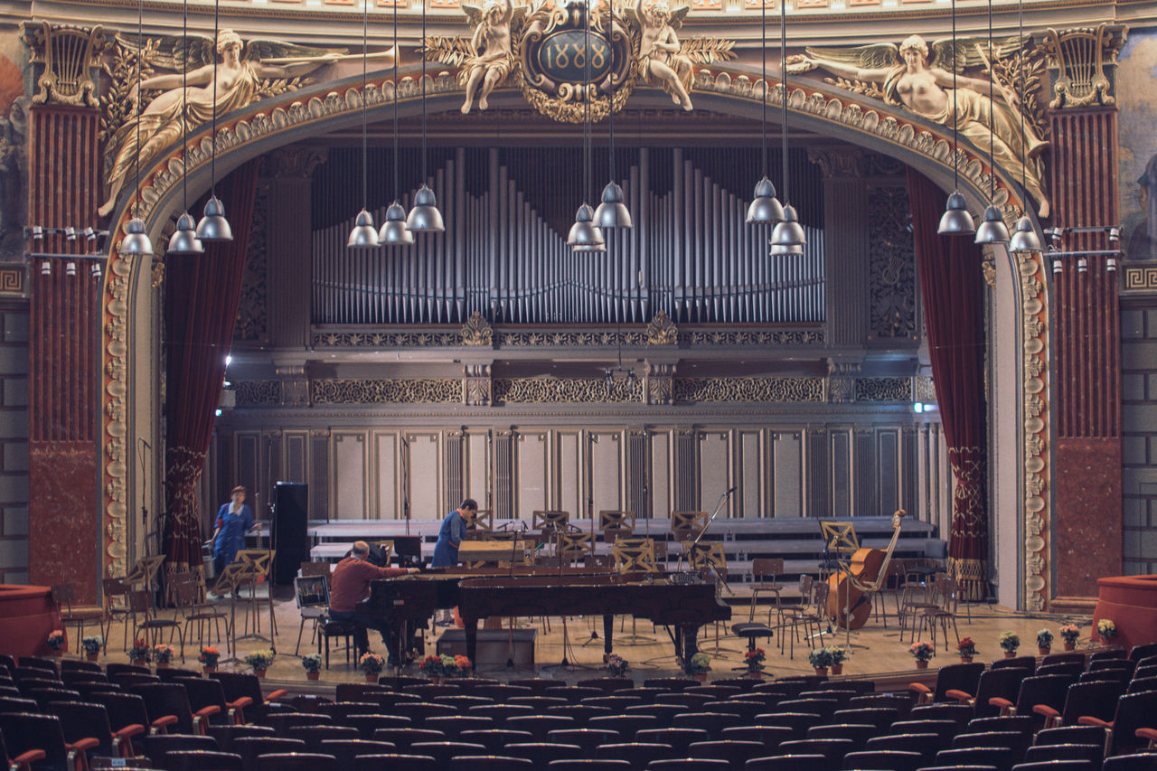 Preparation before big evening Adult Architecture Arts Culture And Entertainment Atheneul Roman Atheneum Classical Music Cleaning Lady Concert Hall  Event Indoors  Interior Design Music People Performing Arts Event Piano Senior Adult Senior Men Stage - Performance Space Tunning Piano Two People