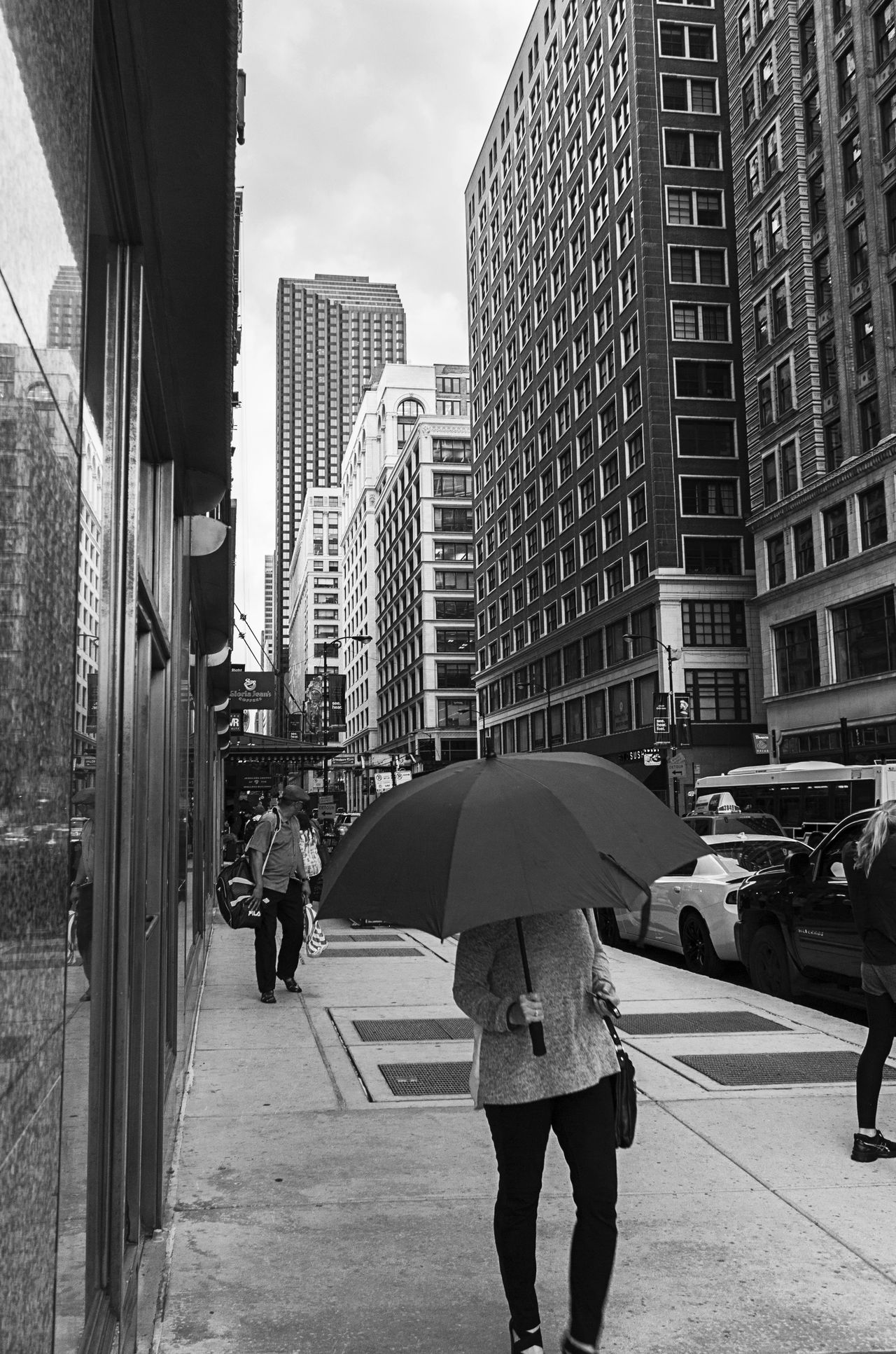 Adult Architecture Black And White Blackandwhite Building Exterior Built Structure City City Life Day Modern Monochrome Outdoors People Rain Rain Rainy Days Real People Sky Skyscraper Umbrella Walk Weather Wet Women