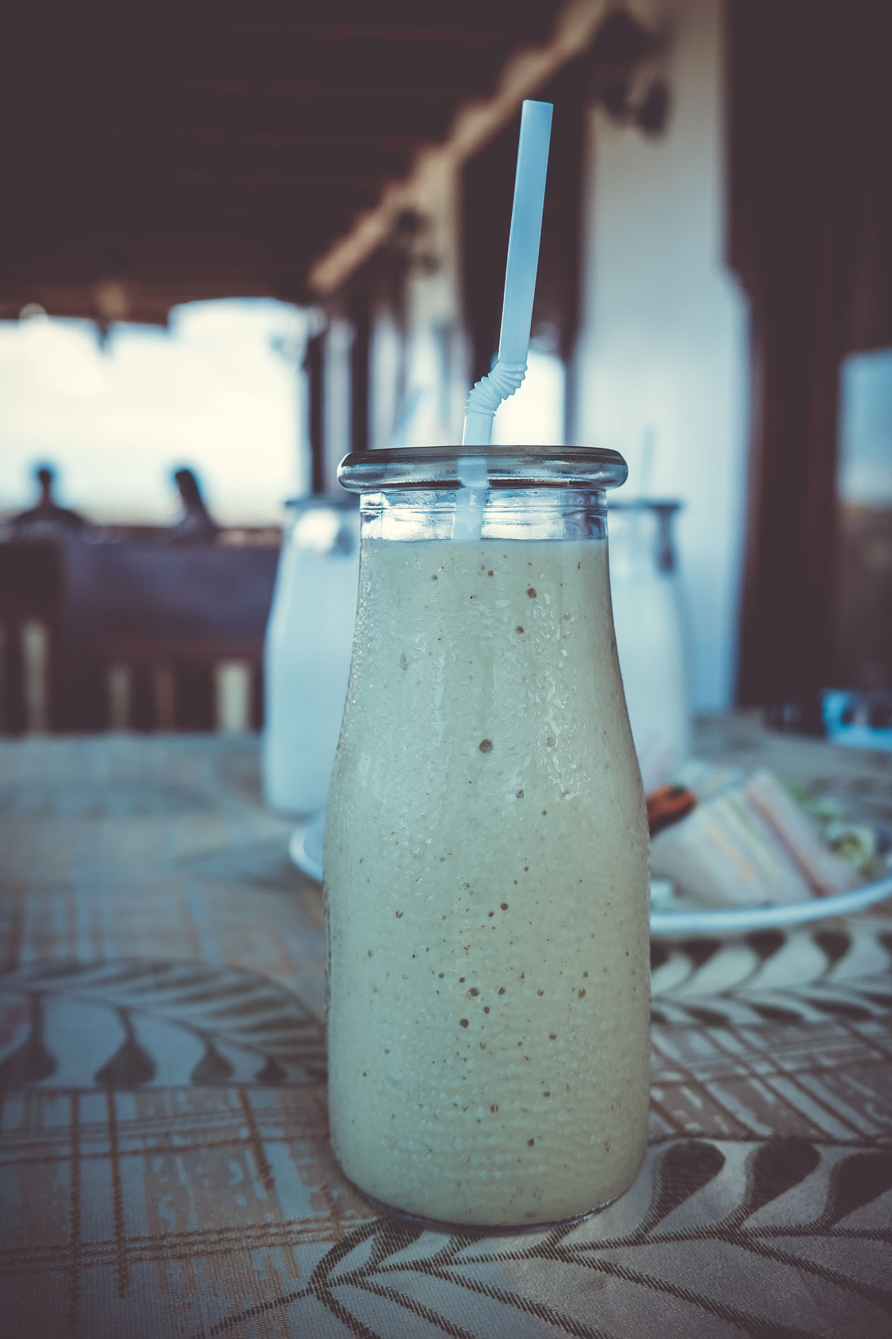 Avocado shake Bottle Close-up Clubhouse Cold Copy Space Crust Ice Diet Drink Drinking Straw Food Food And Drink Freshness Healthy Healthy Eating Indoors  Liquid Real People Refreshment Refreshment Sandwich Selective Focus Snack Table Thirst Visual Feast