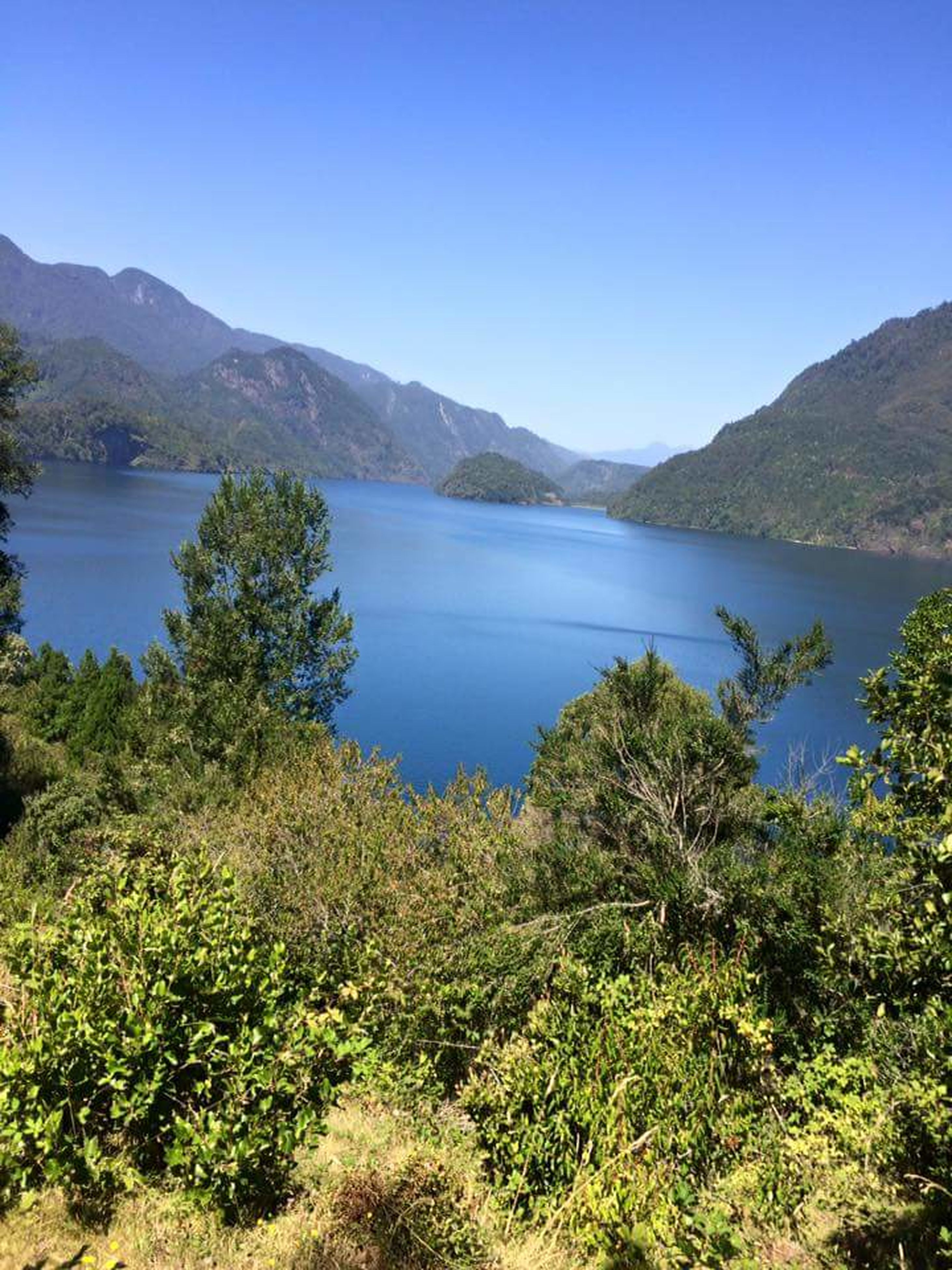 blue, clear sky, water, lake, sky, outdoors, tree, landscape, nature, day, no people