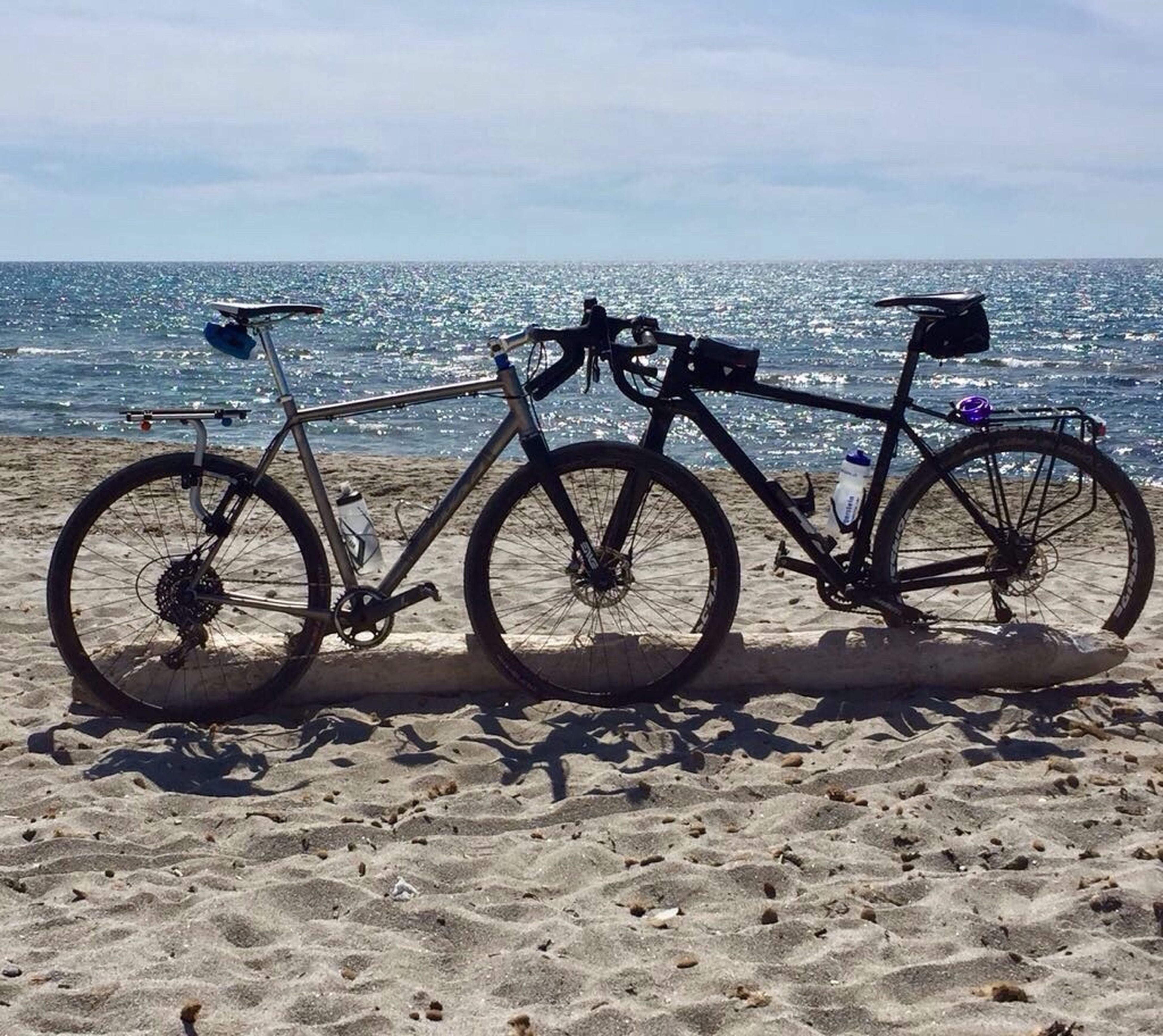 sea, water, horizon over water, outdoors, bicycle, transportation, day, no people, sky, beauty in nature, nature