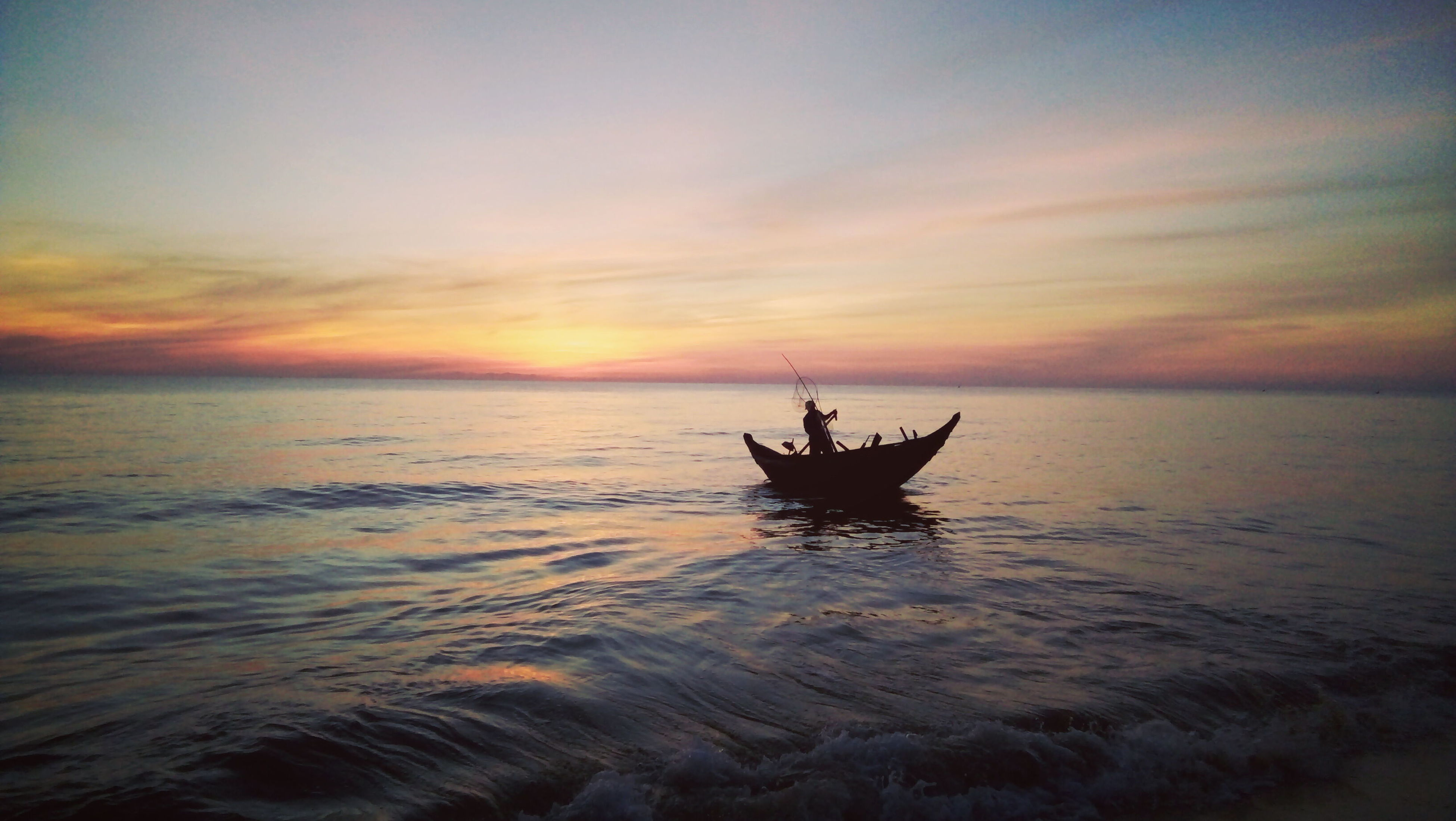 sunset, sea, horizon over water, water, silhouette, scenics, nature, waterfront, beauty in nature, sky, nautical vessel, outdoors, tranquility, tranquil scene, transportation, cloud - sky, men, one person, real people, day, people