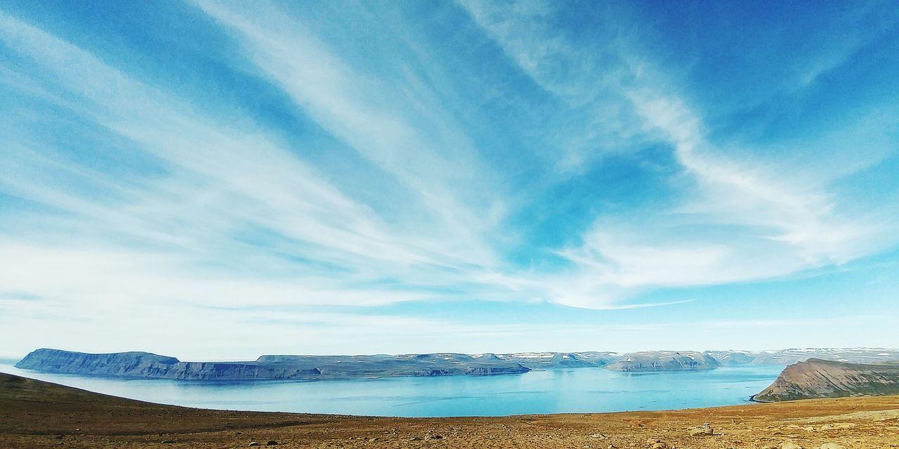 sky, tranquility, scenics, beauty in nature, nature, tranquil scene, blue, outdoors, day, no people, cloud - sky, landscape, water, salt flat, mountain, salt basin, salt - mineral