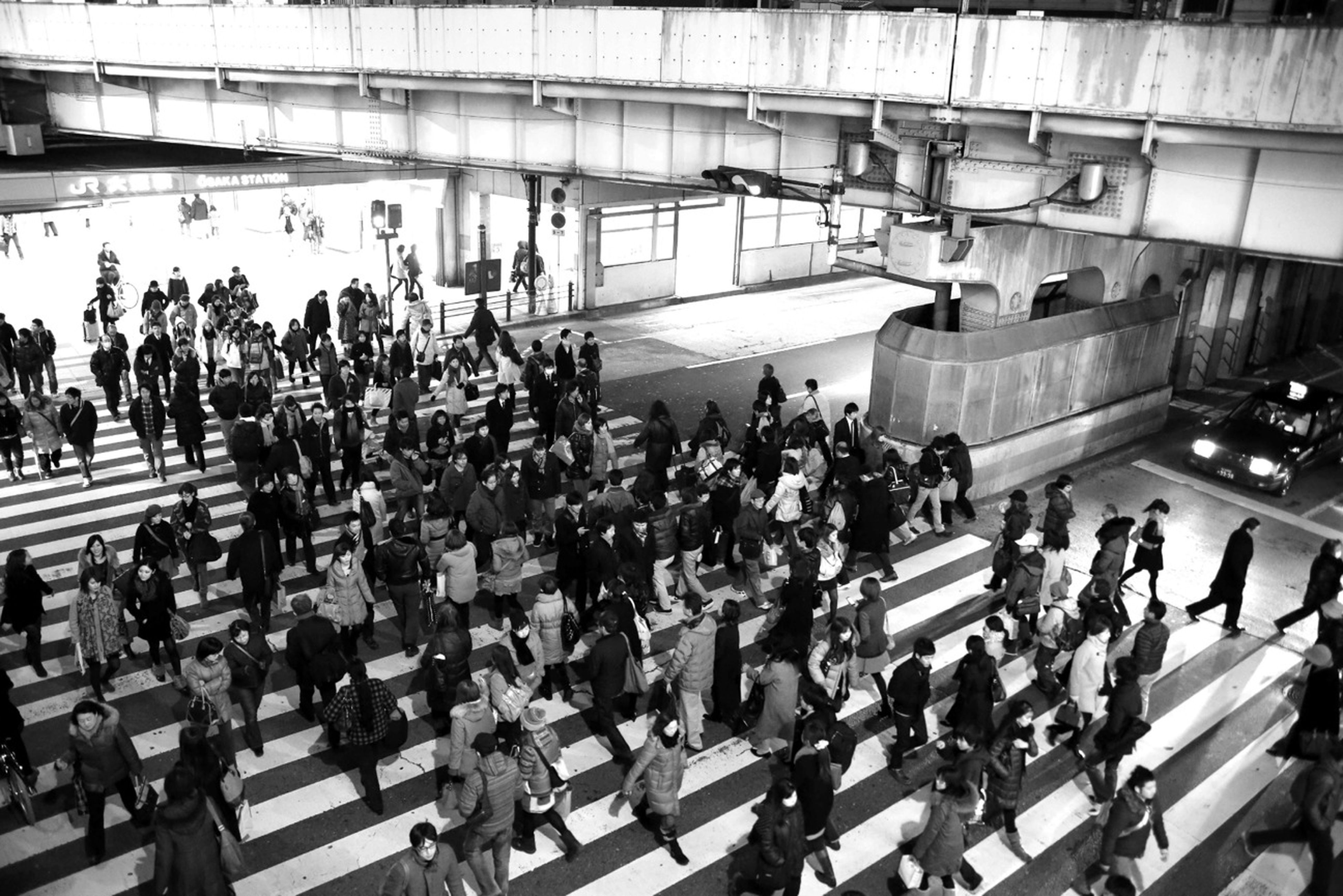 large group of people, transportation, mode of transport, person, men, public transportation, lifestyles, city life, railroad station, travel, high angle view, land vehicle, railroad track, rail transportation, railroad station platform, on the move, walking, leisure activity, mixed age range