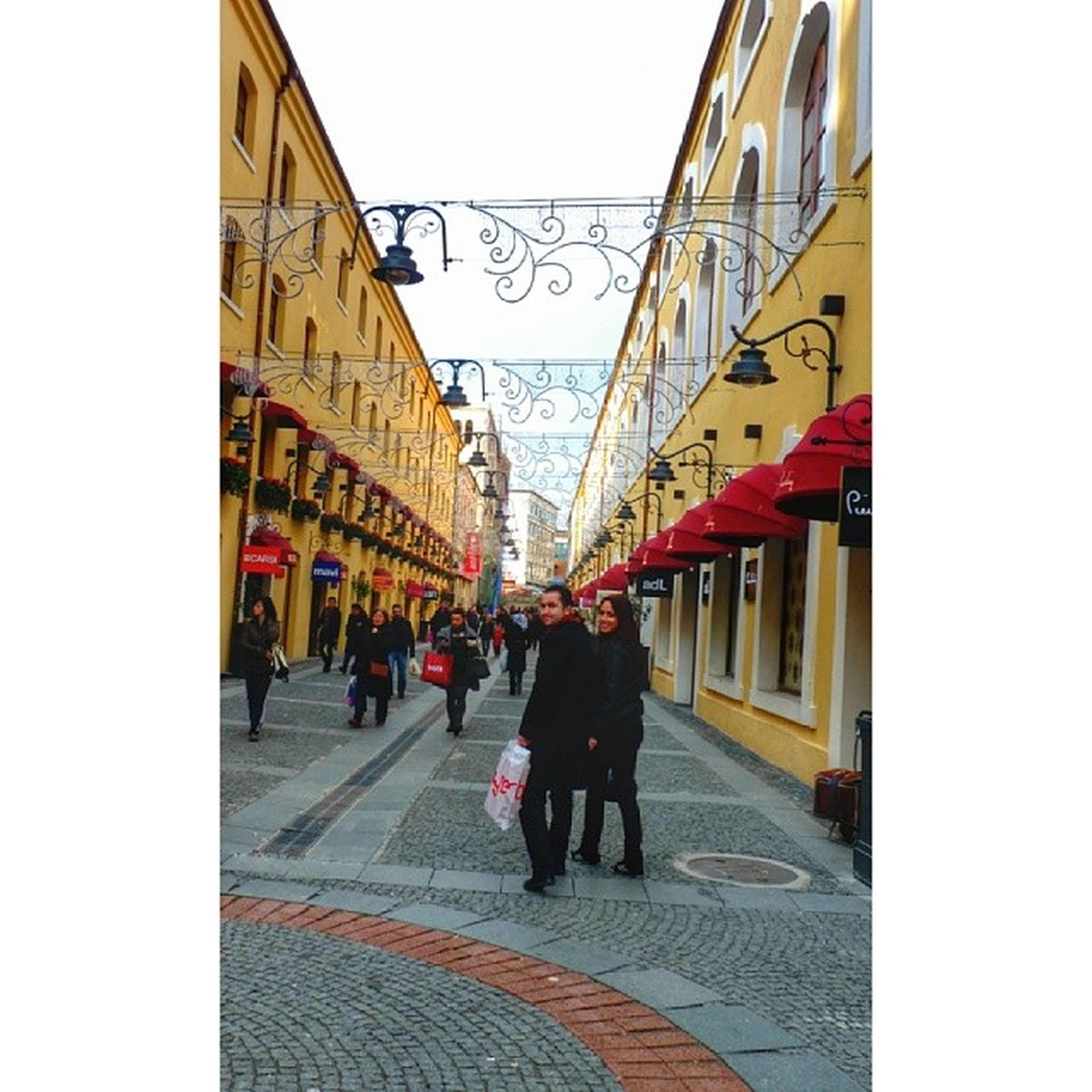 architecture, built structure, building exterior, men, walking, person, clear sky, lifestyles, city, city life, street, large group of people, leisure activity, day, full length, medium group of people, transportation, group of people, building