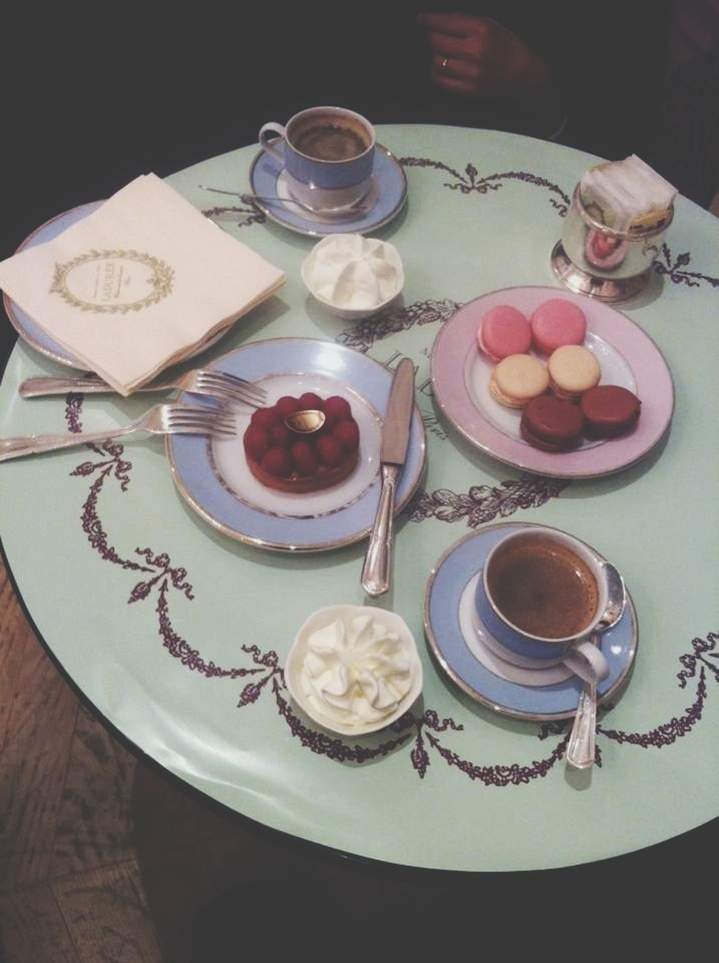 food and drink, indoors, freshness, table, food, still life, plate, drink, ready-to-eat, coffee cup, refreshment, sweet food, high angle view, serving size, indulgence, healthy eating, coffee - drink, breakfast, dessert, saucer