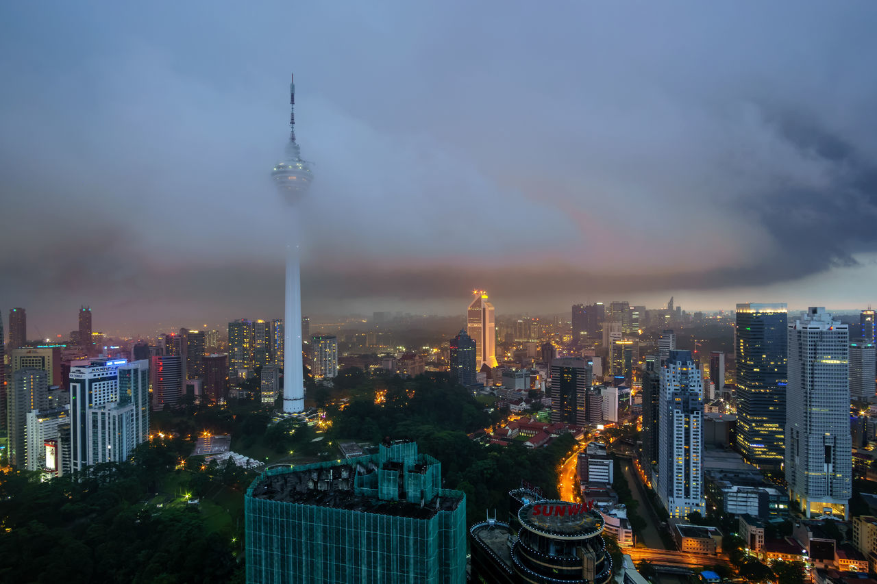 Storm brewing over Kuala Lumpur skyscrapers. The KL Tower is already partially obscured by the low storm cloud Architecture Building Exterior City Cityscape Cultures Downtown District Financial District  Night No People Outdoors Sky Skyscraper Tower Urban Skyline