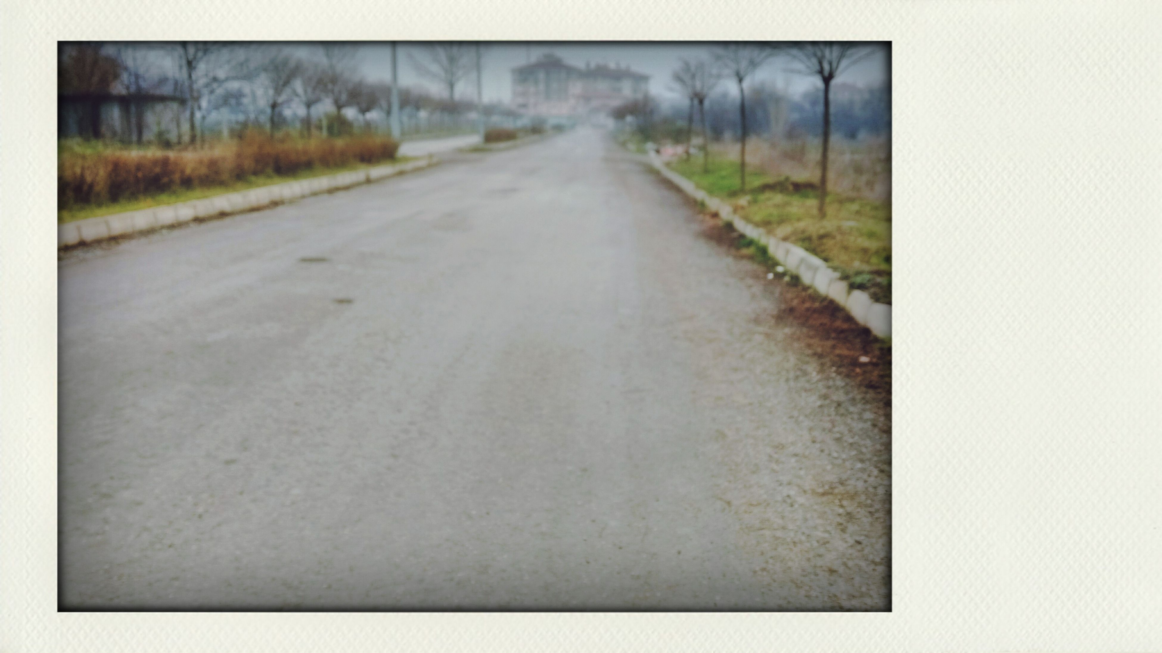 the way forward, diminishing perspective, transfer print, transportation, vanishing point, auto post production filter, road, long, day, empty, surface level, no people, empty road, nature, outdoors, weather, road marking, country road, street, railroad track