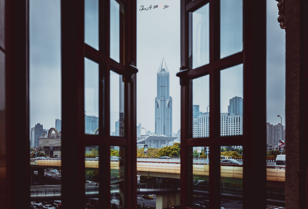 architecture, built structure, window, sky, indoors, building exterior, cityscape, city, no people, day, travel destinations, water, skyscraper, nature