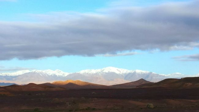 From A Bus Window Round Trip Morocco Mountains And Sky Impressive Locations Capture The Moment Colourful World Opposite Attraction Desert Against Snowy Mountains Desert Beauty