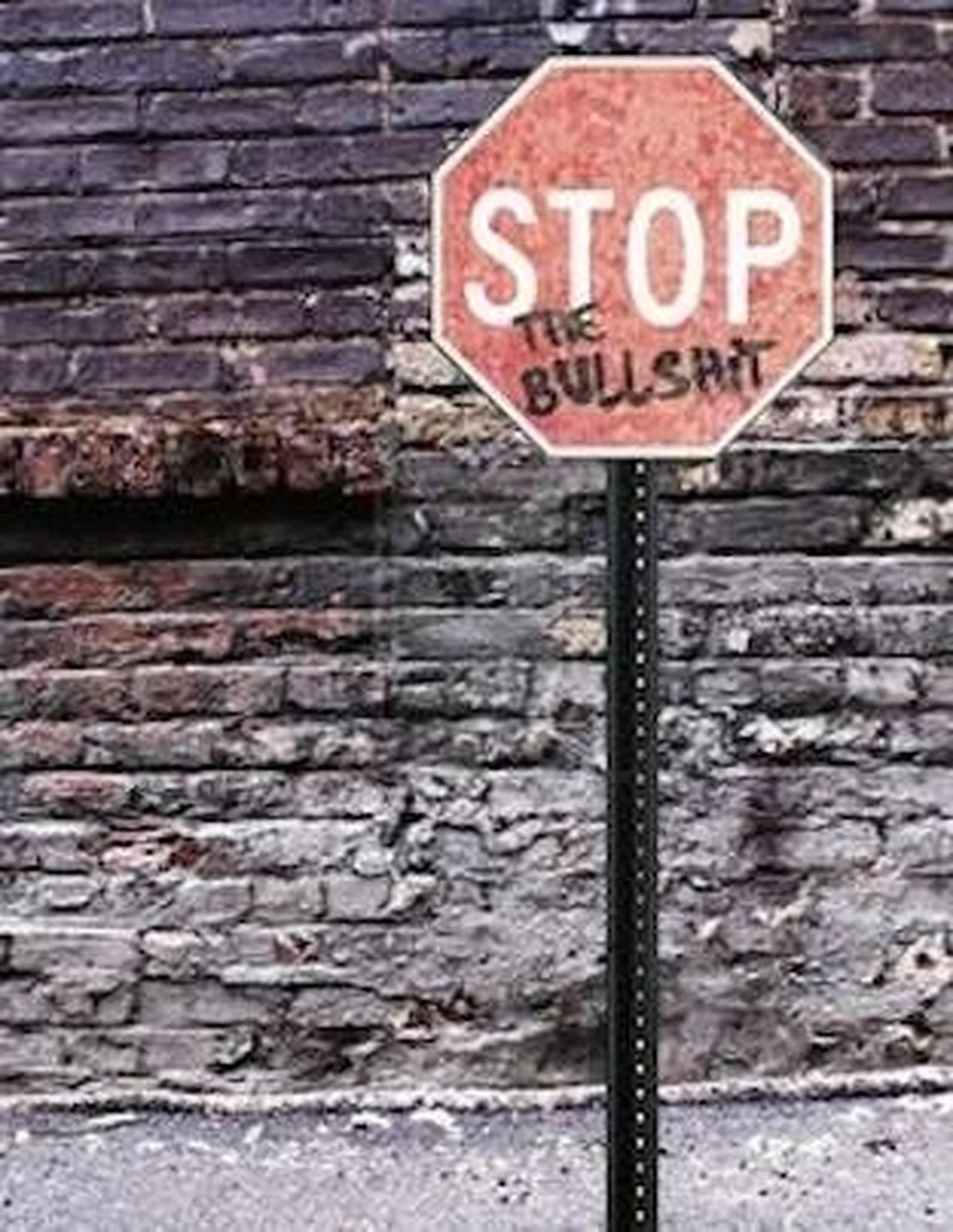 text, communication, brick wall, western script, architecture, wall - building feature, built structure, building exterior, information sign, red, guidance, road sign, wall, sign, information, brick, capital letter, non-western script, stone wall, day