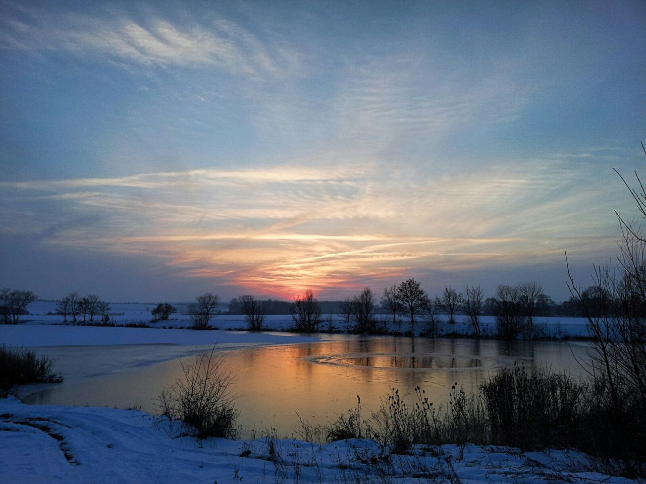 cold temperature, winter, nature, tranquil scene, beauty in nature, scenics, sunset, snow, tranquility, sky, no people, cloud - sky, lake, outdoors, water, tree, bare tree, landscape, day
