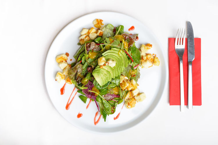 Fresh salad on a plate, isolated on white Avocado Food Food And Drink Freshness Gourmet Halloumi Healthy Eating Isolated No People Plate Ready-to-eat Salad Savory Food Spinach Wild Herbs