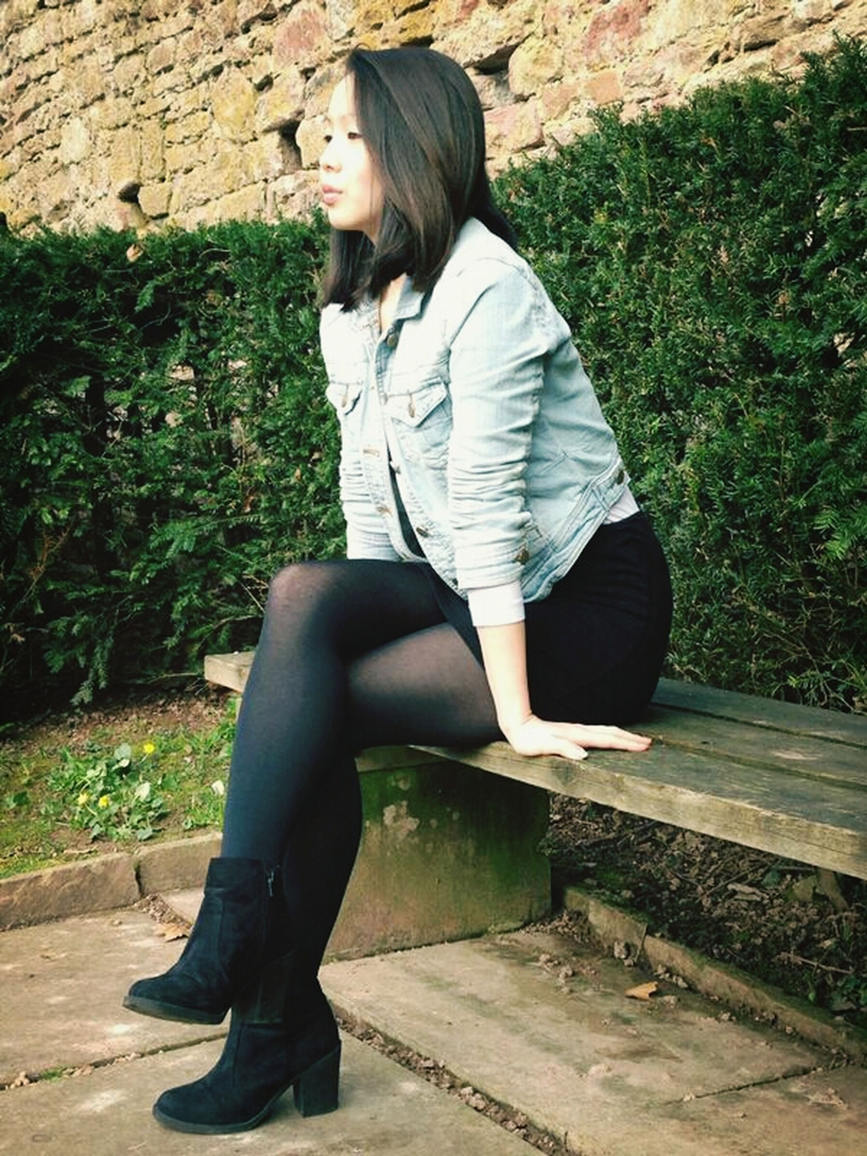casual clothing, lifestyles, young adult, full length, person, standing, leisure activity, young women, three quarter length, front view, side view, long hair, sitting, leaning, day, looking away, jacket