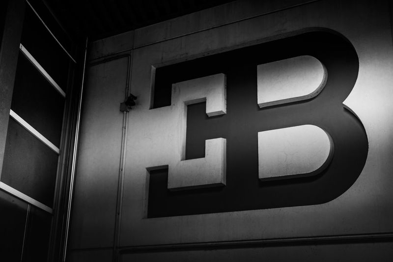 Abandoned Alphabet Basrelief Black & White Bugatti Car Classic Close-up Day Etched Ettore Bugatti Factory Industry Italian Italy Logo Low Angle View Luxury Monochorme No People Sports Car Stone Super Car Vintage